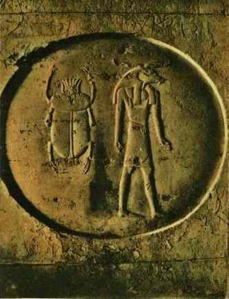 A scarab beetle and the god Anubis carved in a circle in Seti's tomb.